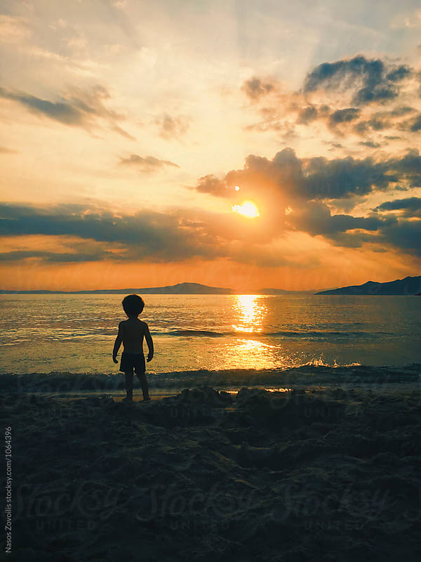 1 year old boy watching the sunset by Nasos Zovoilis for Stocksy United