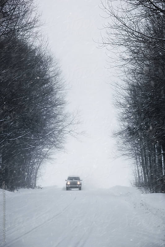 Truck approaching on snow covered road by Sandra Cunningham for Stocksy United