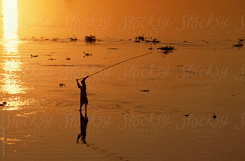 silhouette of fisherman on the Nile. Egypt by Hugh Sitton for Stocksy United