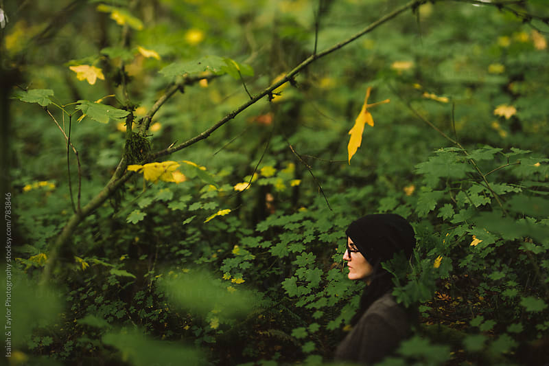 Woman in leaves by Isaiah & Taylor Photography for Stocksy United