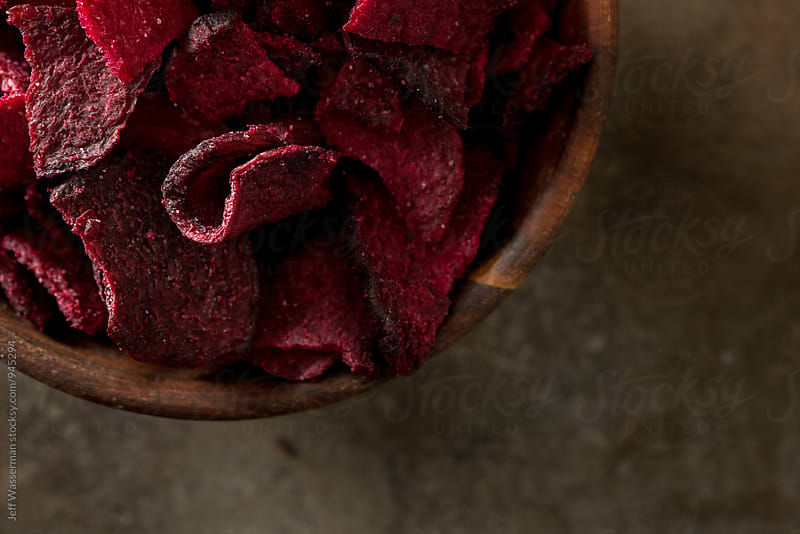 Beetroot Chips Closeup From Above by Jeff Wasserman for Stocksy United