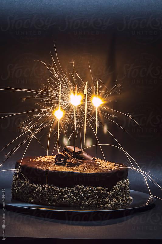 chocolate cake with sprinklers by Igor Madjinca for Stocksy United