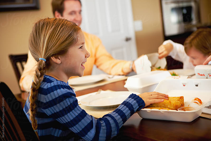 Family:Girl Having Egg Rolls at Dinnertime by Sean Locke for Stocksy United