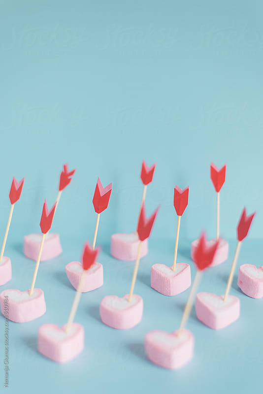 Pink Heart Shape Marshmallows Pierced With Red Arrows   by Nemanja Glumac for Stocksy United