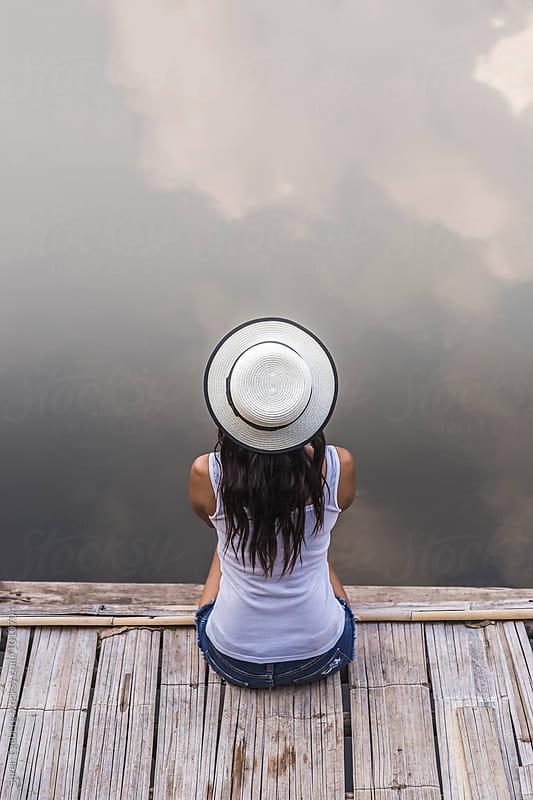 Girl sitting on a pier by Soren Egeberg for Stocksy United