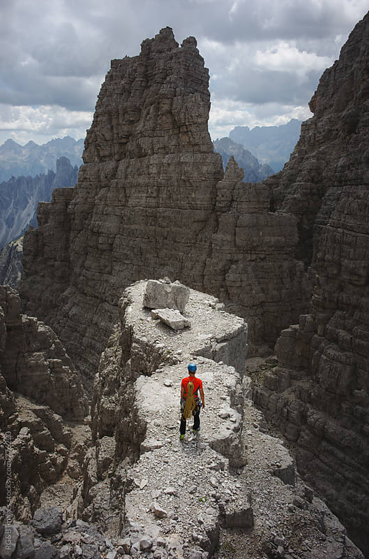 Rock climber standing on top of the rock in Dolomites by RG&B Images for Stocksy United