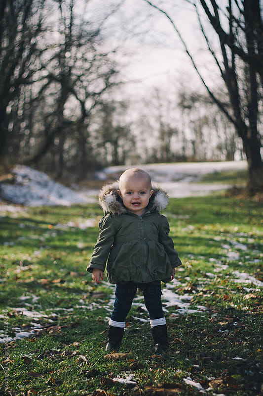 Toddler Girl Standing Outside in the Snow by Kevin Keller for Stocksy United