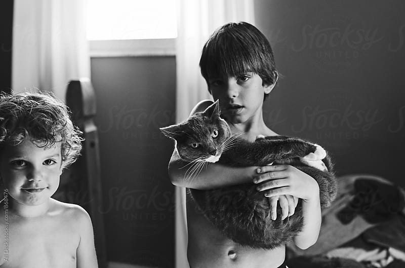 Boy and Cat by Ali Deck for Stocksy United