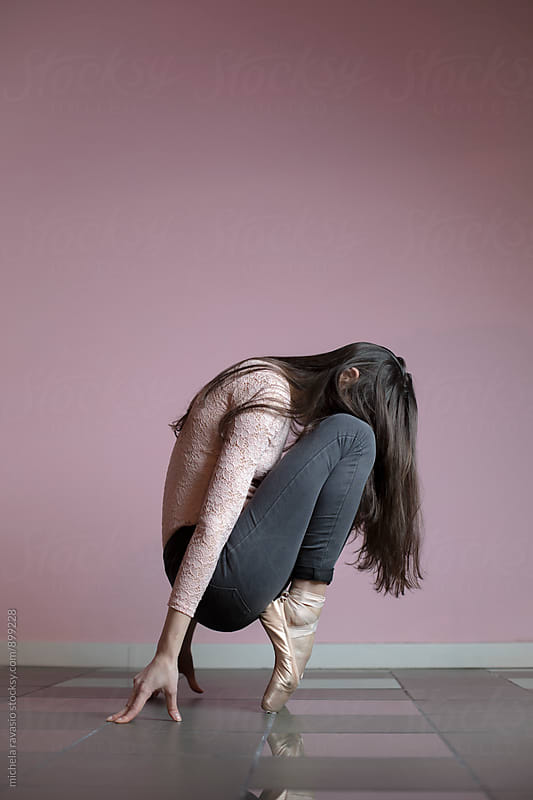 Performance of a young dancer with pointed shoes by michela ravasio for Stocksy United