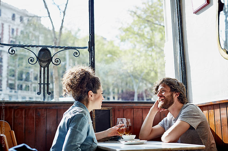 Cheerful Couple Having Wine In Restaurant by ALTO IMAGES for Stocksy United