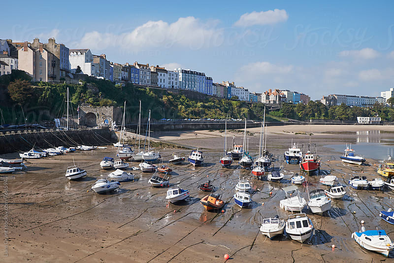 Boats in Tenby Harbour at low tide. Wales, UK. by Liam Grant for Stocksy United