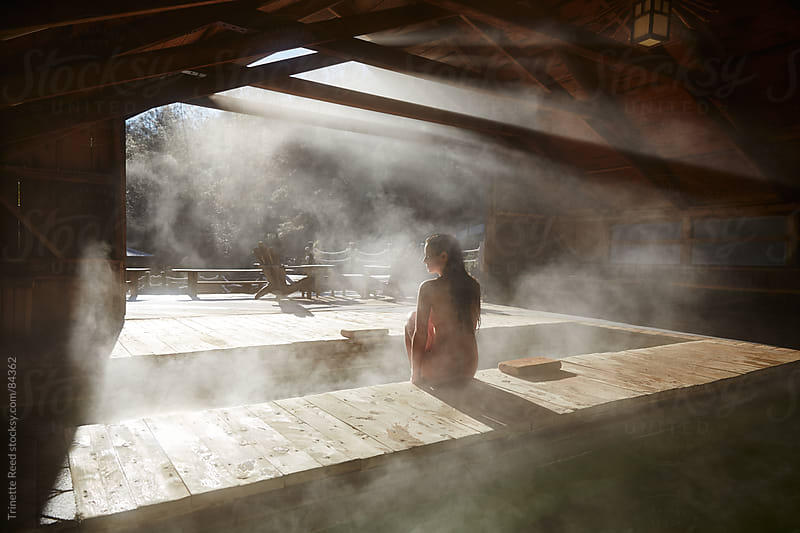Woman relaxing at Japanese spa and hot springs in California by Trinette Reed for Stocksy United