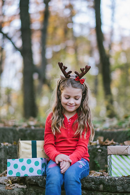 Portrait of a Cute Littile Girl with Reindeer Horns  by Aleksandra Jankovic for Stocksy United