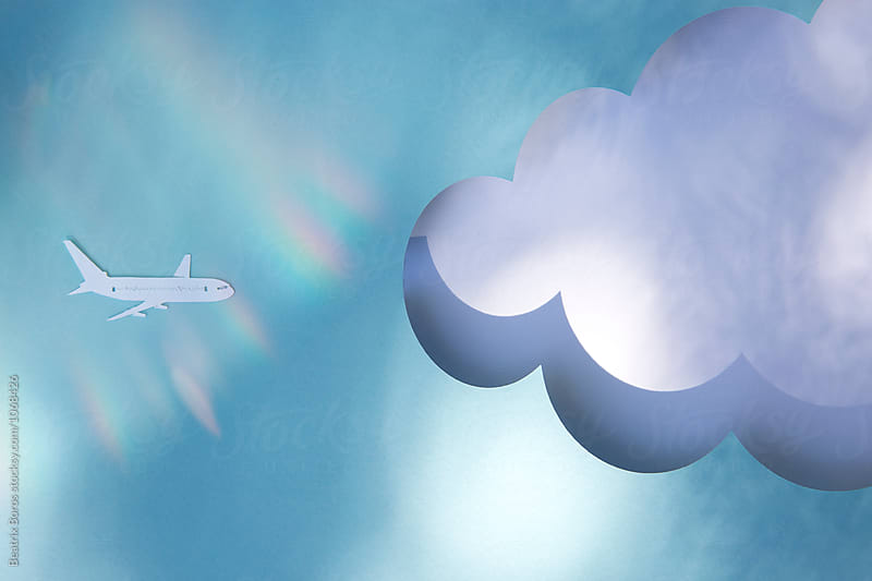 Paper airplane flying towards a cloud mock-up by Beatrix Boros for Stocksy United