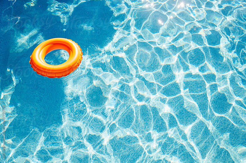 Inflatable rubber ring in a swimming pool by sally anscombe for Stocksy United