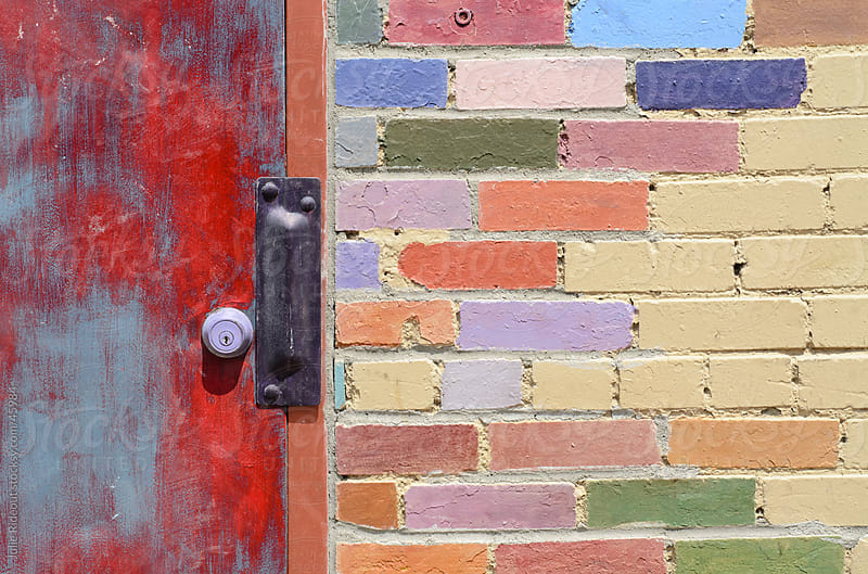 Door and Colored Brick Wall by Julie Rideout for Stocksy United