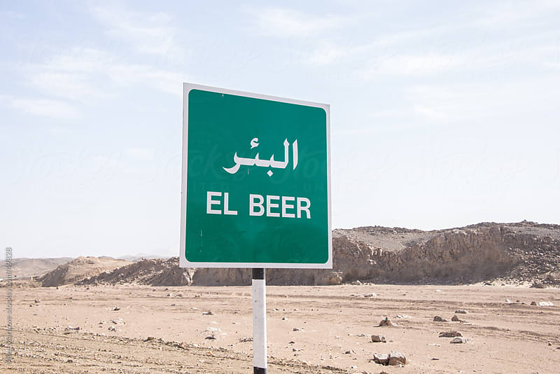 Road sign showing the name of a town called beer by Mike Marlowe for Stocksy United