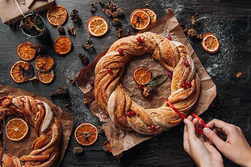 Cinnamon wreaths with dried oranges by Nataša Mandić for Stocksy United