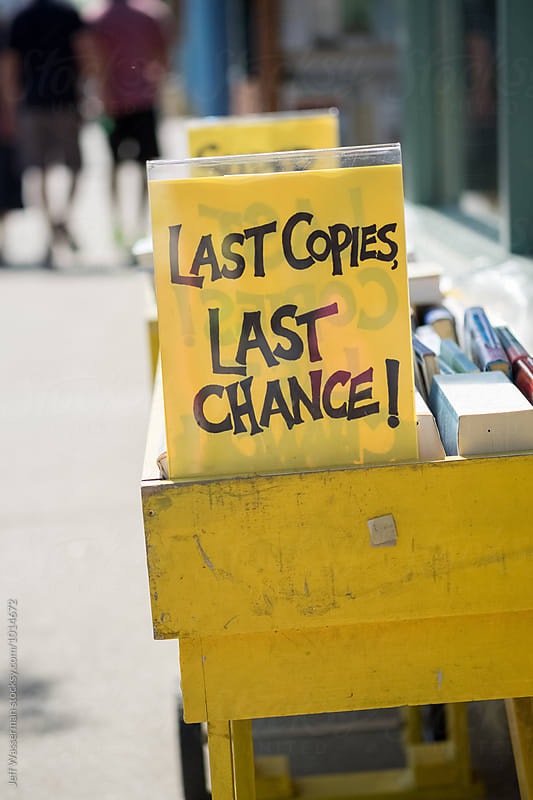 Sign on Book Bin: Last Copies, Last Chance! by Jeff Wasserman for Stocksy United