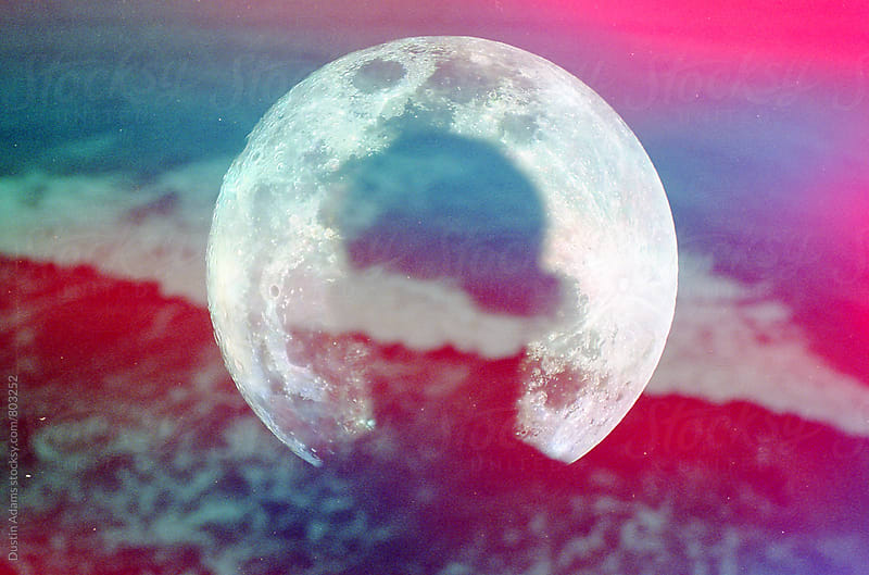 Double Exposed Moon Over Ocean  by Dustin Adams for Stocksy United