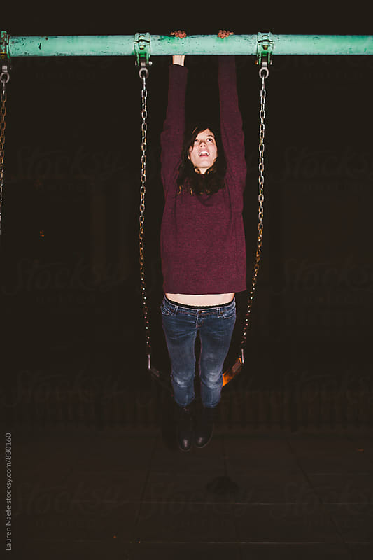 Playing on the swings by Lauren Naefe for Stocksy United