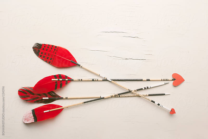 Hipster arrows with red feathers and hearts. Valentine's day. by BONNINSTUDIO for Stocksy United