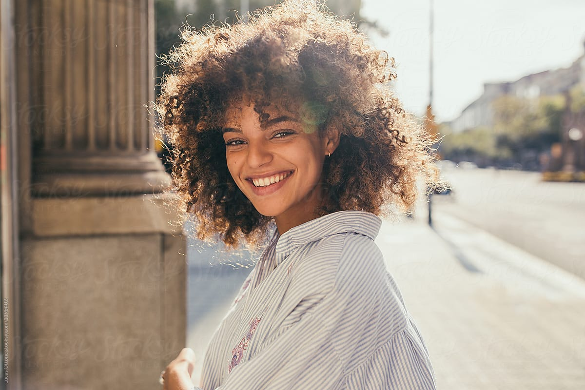 Beautiful Mixed Race Woman Smiling By Lucas Ottone Afro Beauty Stocksy United