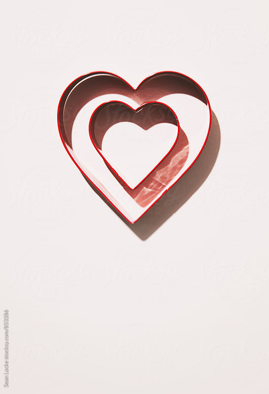 Valentine: One Heart Shape Cookie Cutter Within Another by Sean Locke for Stocksy United