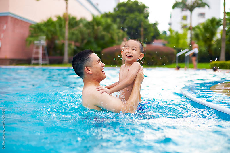 happy father with his son in the swimming pool