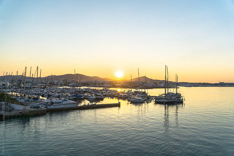 View of a touristic port at sunrise by ACALU Studio for Stocksy United