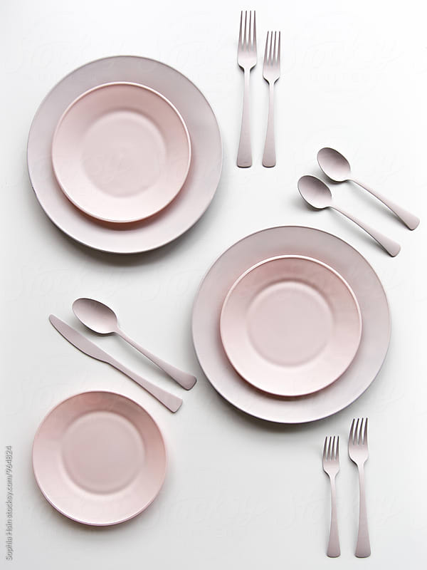 Pink plates by Sophia Hsin for Stocksy United