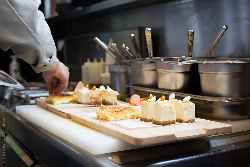 Cheesecake Dessert Being Prepared in Modern Bright Restaurant Kitchen by Julien L. Balmer for Stocksy United