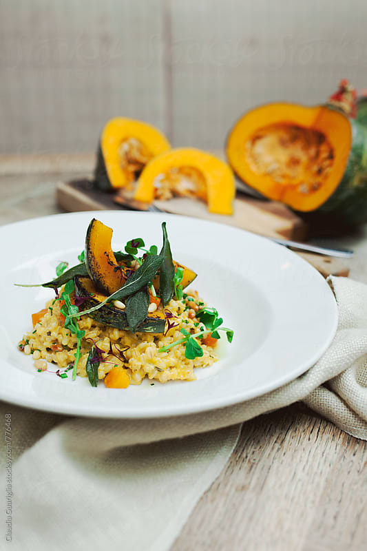 Pearl barley with pumpkin and sage by Claudia Guariglia for Stocksy United