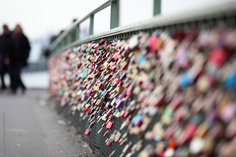Romantic love locks on a bridge by Marcel for Stocksy United