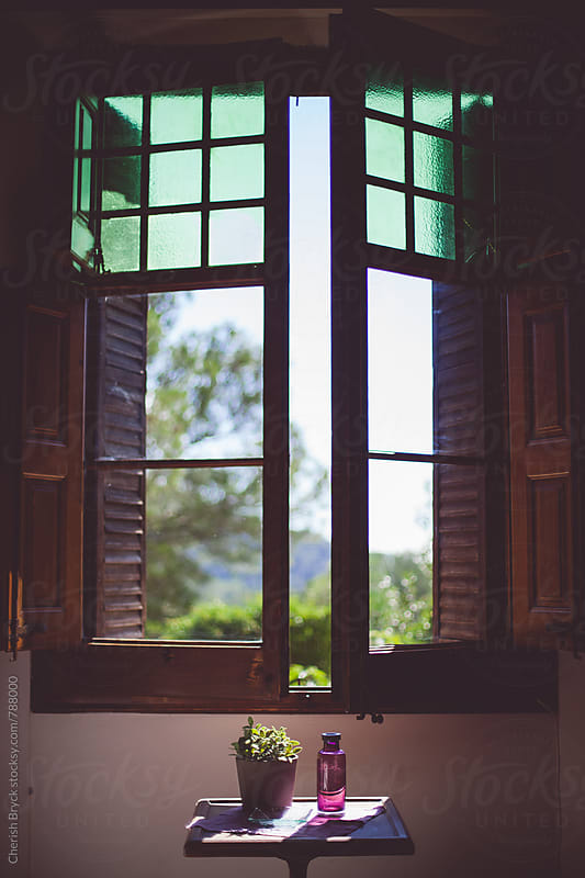 Open the window and let some fresh air in! by Cherish Bryck for Stocksy United
