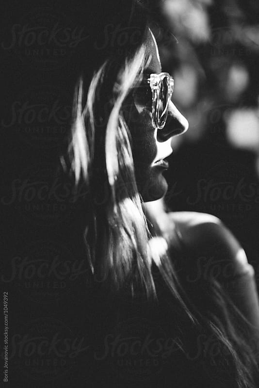 Close up black and white portrait of a young woman by Boris Jovanovic for Stocksy United