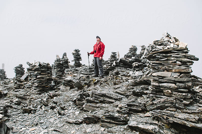 Female trekker on the lower summit of Chhukung Ri Peak, waiting for the sun to come out, Nepal. by Thomas Pickard for Stocksy United