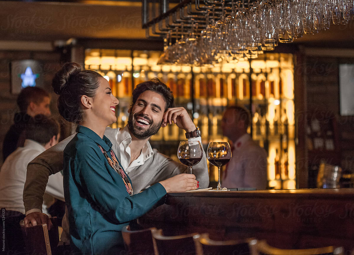 Couple Drinking Wine at the Bar by Mosuno for Stocksy United