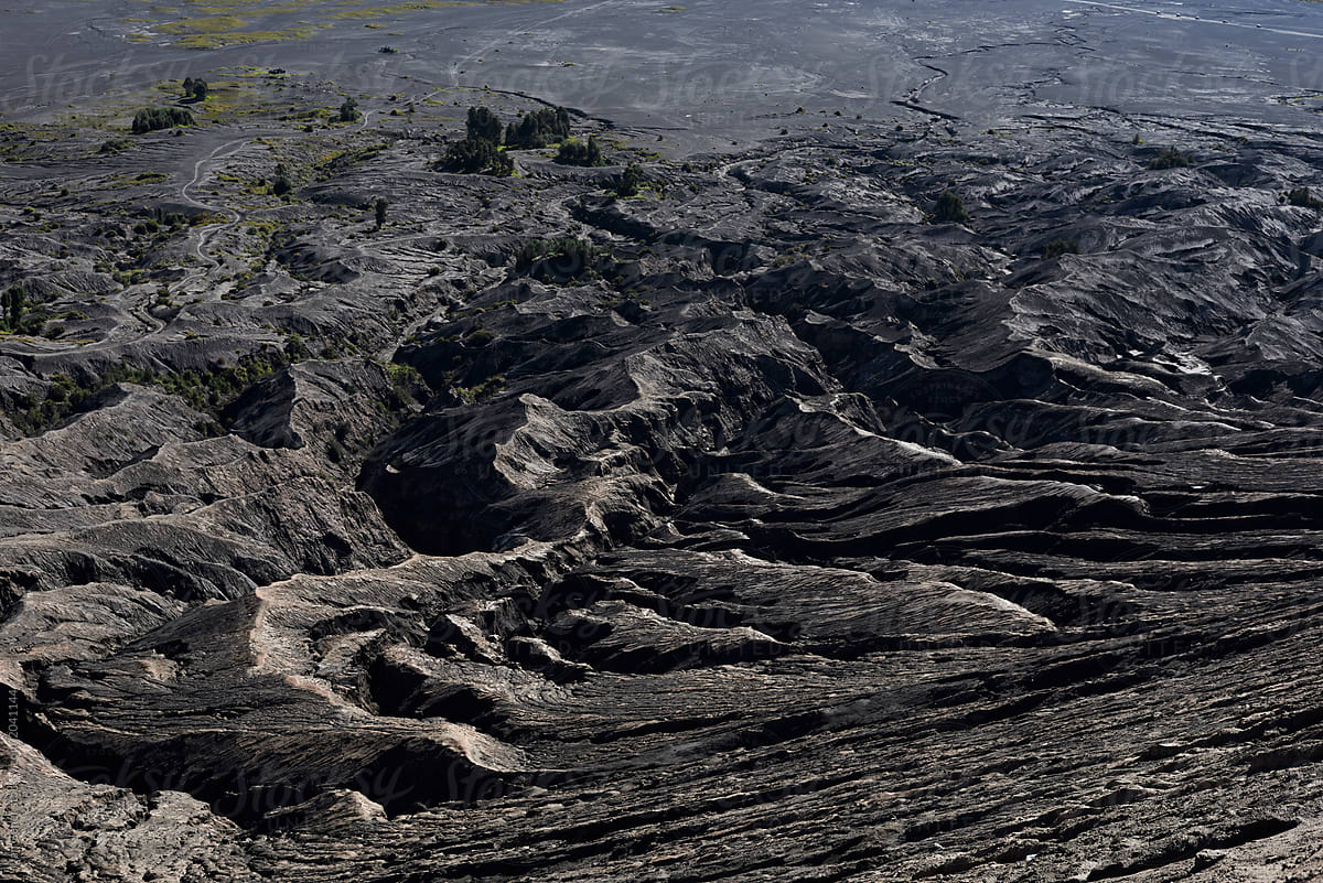 Rocky lava landscape view from the top of active volcano mount bromo by ivan gener