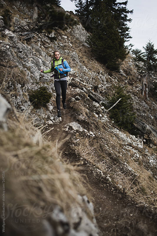 girl runs in the mountain by Wolfgang Lienbacher for Stocksy United