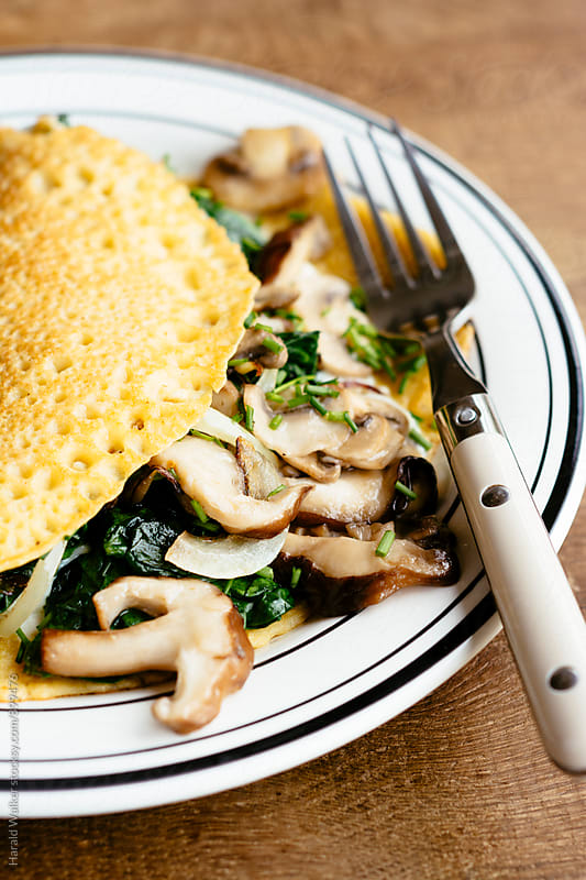 Creamy shiitake and spinach crepes by Harald Walker for Stocksy United