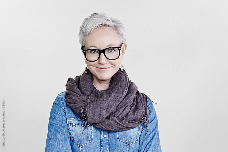 Portrait of stylish mature woman with grey hair  by Trinette Reed for Stocksy United
