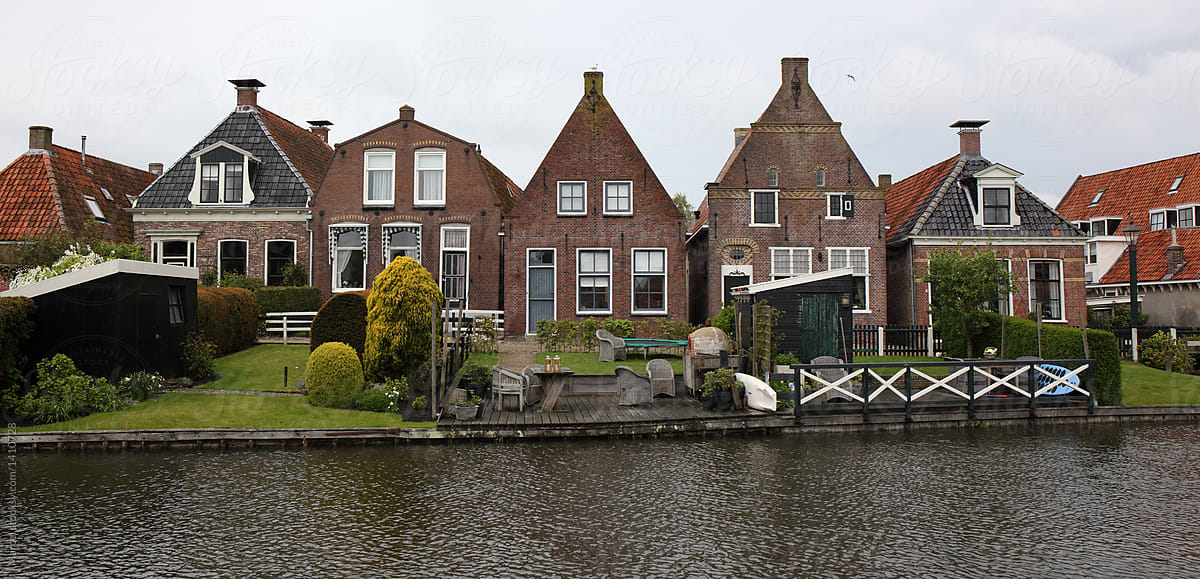 Old Dutch Houses Along A Canal Stocksy United