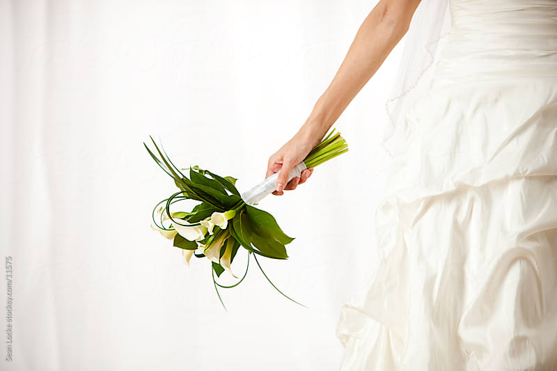 Wedding: Bride Holding Bouquet to Side by Sean Locke for Stocksy United