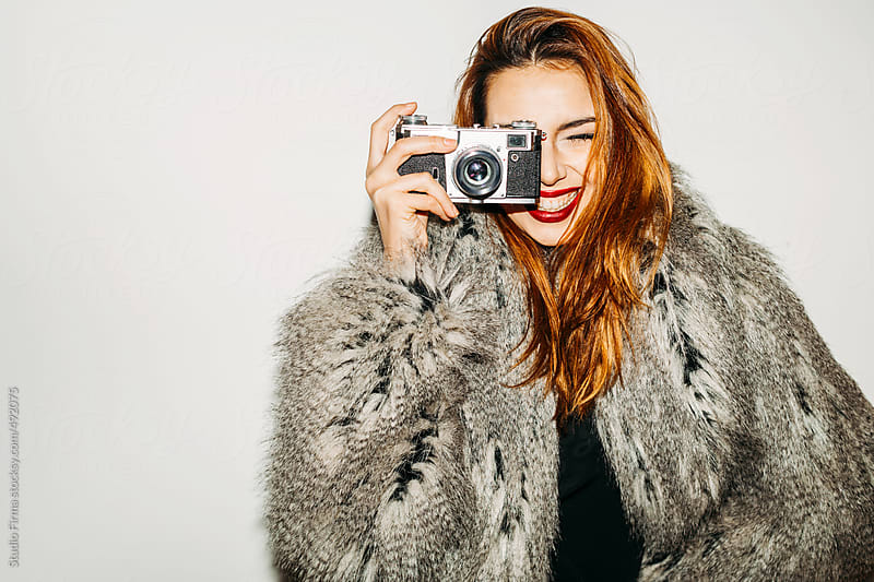 Portrait Of a Woman With Retro Camera by Studio Firma for Stocksy United