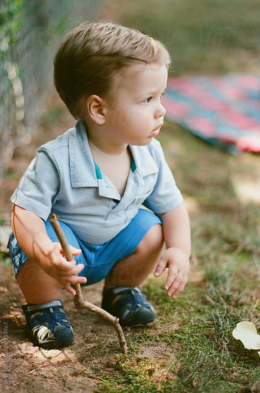 Cute toddler playing outside by Jakob for Stocksy United