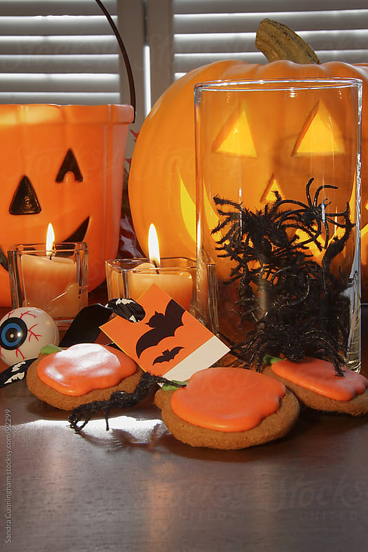 Pumpkins, candles and cookies for Halloween by Sandra Cunningham for Stocksy United