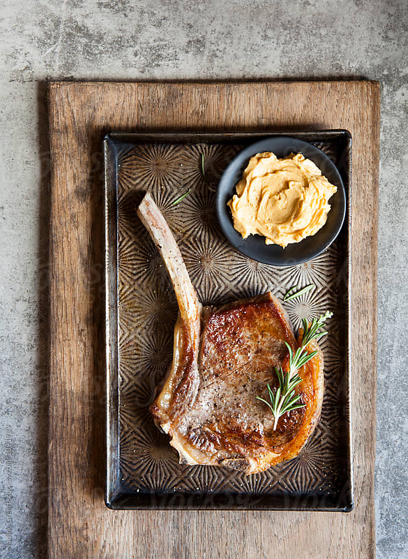 Juicy steak with whipped miso butter by Nadine Greeff for Stocksy United