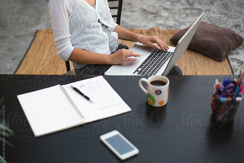 Young woman working from home by Jovo Jovanovic for Stocksy United