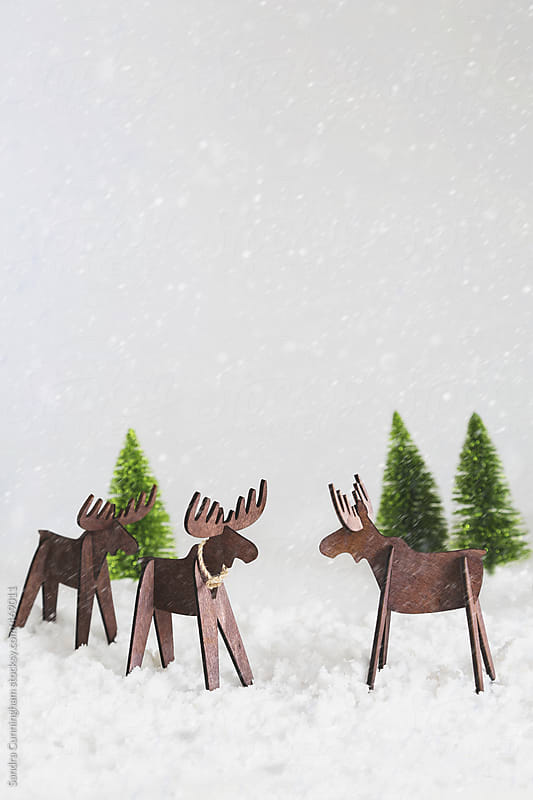 Wooden reindeer in snow  by Sandra Cunningham for Stocksy United